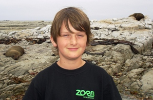 Alex with seals at Ohua Point New Zealand