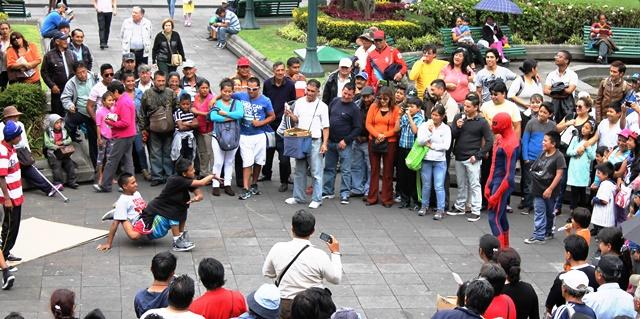 Children break-dancing in Main Square Quito, Ecuador - image Zoe Dawes