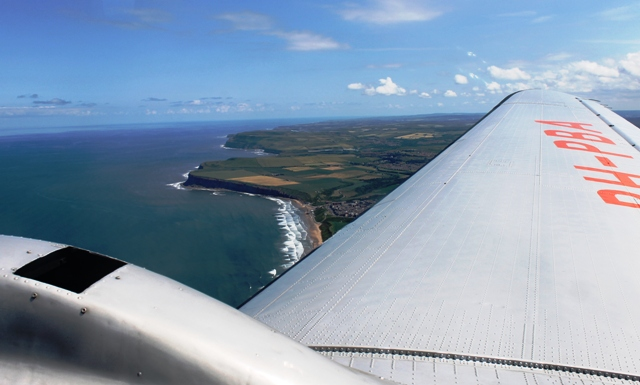 KLM Dakota DC-3 over NE Coast - by Zoe Dawes