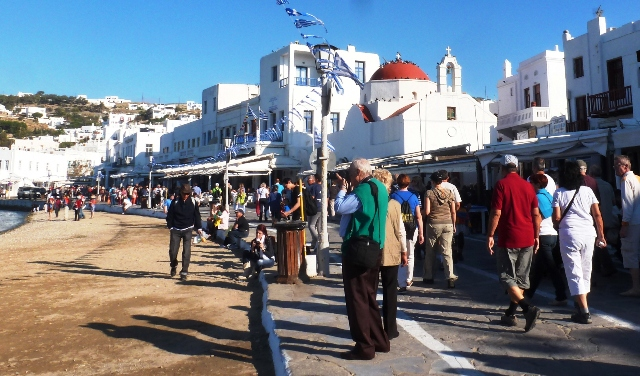 Mykonos town tourists and beach - by Zoe Dawes