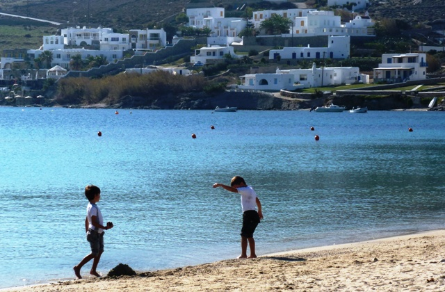 Ornos beach boys, Mykonos, Greece - by Zoe Dawes