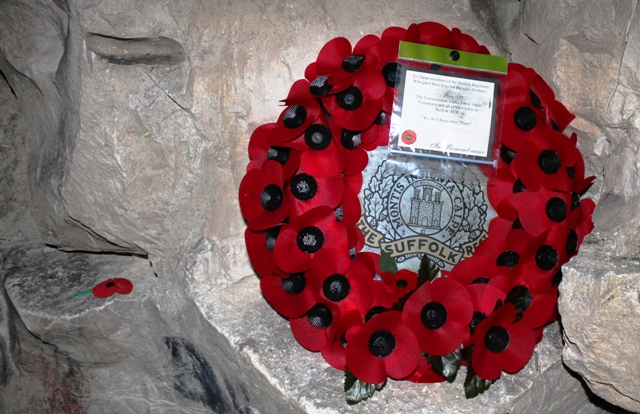 Poppy wreath Suffolk Regiment in Wellington Quarry, Arras France - image Zoe Dawes