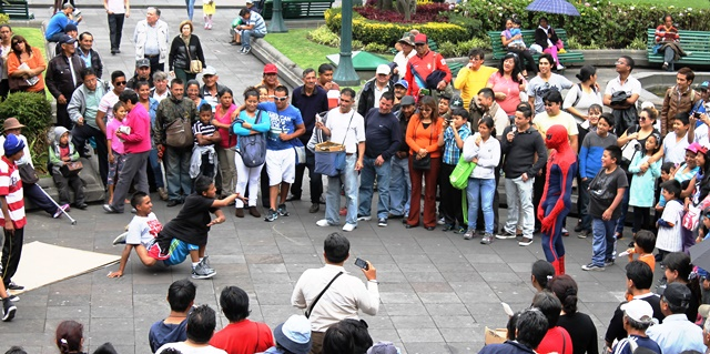 Children break-dancing in Main Square Quito, Ecuador - image Zoe Dawes