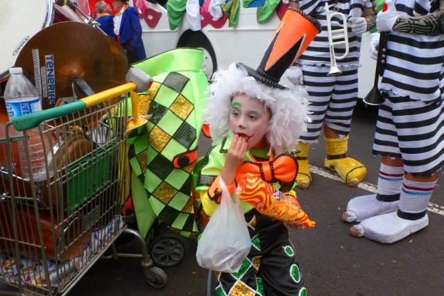 Clown eating crips Tenerife Carnival - by Zoe Dawes