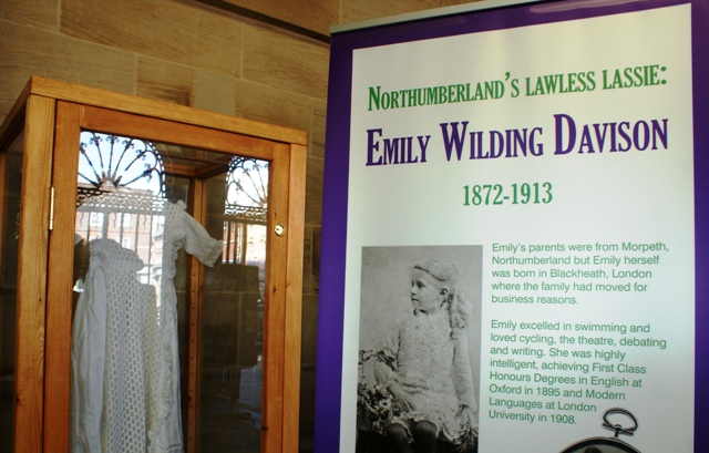 Emily Wilding Davison poster and christening gown