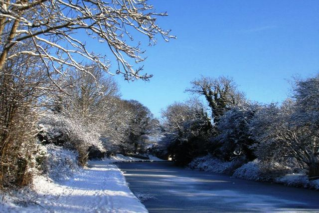 Lancaster Canal in winter snow at Carnforth, Lancashire - by Zoe Dawes