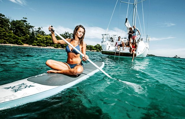 Yacht and paddle board